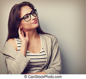 Thoughtful young casual woman looking Closeup vintage...