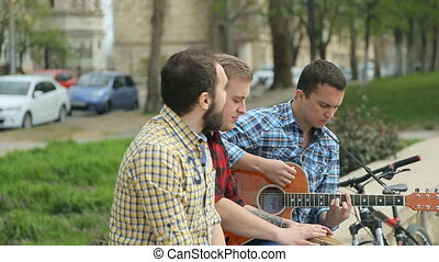 Funny spirited musicians sing songs and play musical instruments on the street