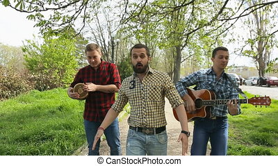 The guys in plaid shirt walking down the street and sing and...