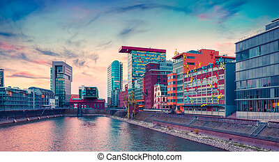 Colorful view of Rhine river at evening in Dusseldorf....