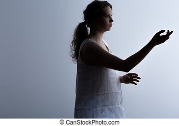 Clinically dead beauty woman standing with raised hand