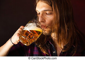 handsome young man drinking beer - handsome young man guy...