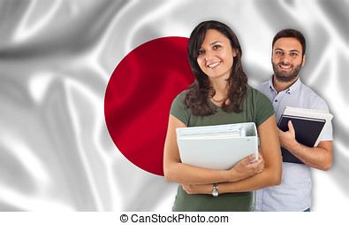 Couple of students over japanese flag - Couple of young...