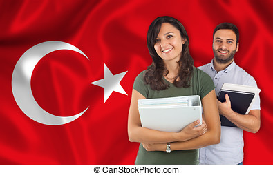 Couple of students over turkish flag - Couple of young...