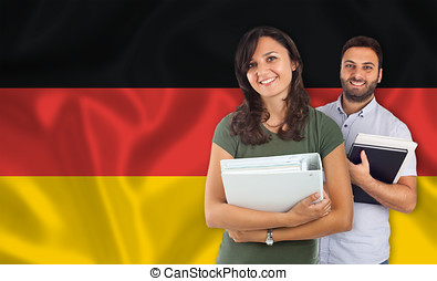 Couple of students over german flag - Couple of young...