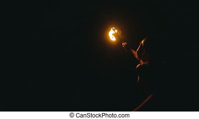Fire show - Adult caucasian man spitting fire, smaller fire...