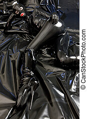 lying woman wearing latex clothes