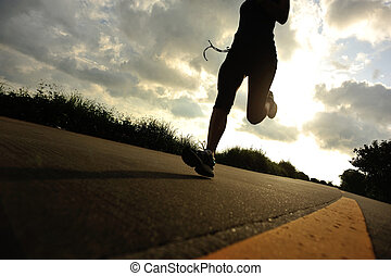 Runner athlete running at seaside road woman fitness...