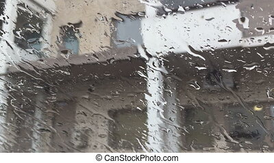 Waterdrops on a glass surface - Rain drips on the glass in...