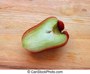 Rose apple on the wood background