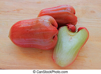 Rose apple isolated on the wood background