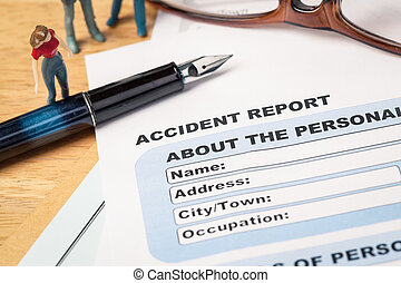 Accident report application form and pen on brown envelope...
