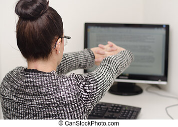 woman behind desk stretching arms - woman behind desk...