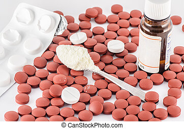 pills and medicine - red pills and spoon