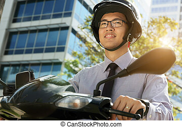 Chinese Businessman Commuter With Scooter Motorcycle In The Morning