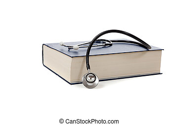 Medical reference book with a stethoscope on white - A...
