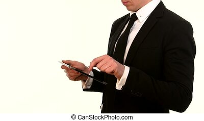 Businessman using his smart phone on white - hands touching...