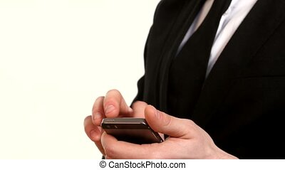 Businessman using his smart phone on white