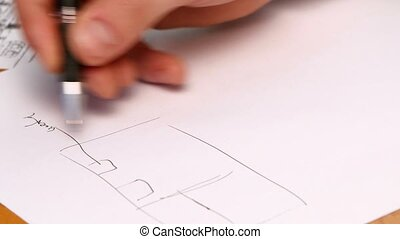 Person's Hand Drawing Plan On Blue Print. Close-up
