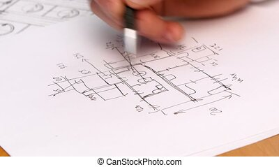Persons Hand Drawing Plan On Blue Print Close-up