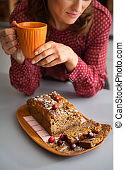 Closeup of womans hands holding mug with home-made baking -...