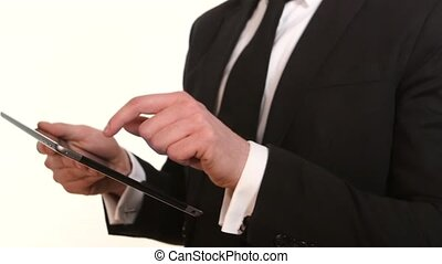 Businessman working with tablet PC on white. Slow motion -...