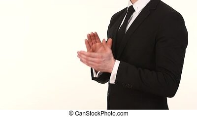 Businessman male hands clapping on black, side-view. Slow motion