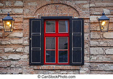 facade of the building , window a red- black - facade of the...