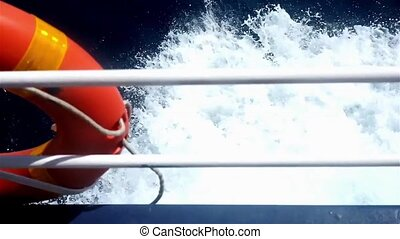 Life buoy is on the side of a boat - Life buoy on the side...