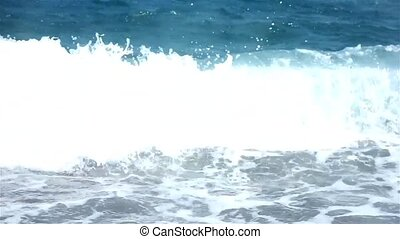 Waves rush onto the beach
