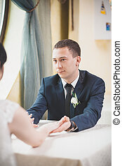 groom looking at bride