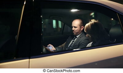 Mobile Negotiation - Tracking shot of two business partners...