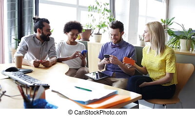 happy business team with smartphones in office - business,...