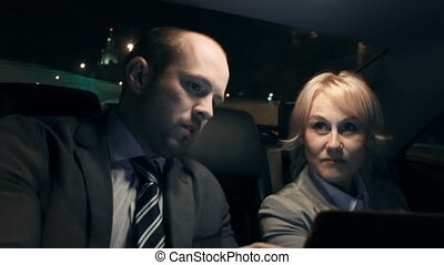 Business People in Taxi - Close up of people sitting in a...