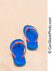 blue Rubber slippers on the beach - blue Rubber slippers on...