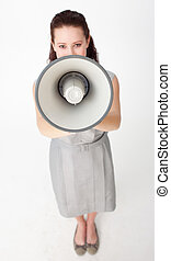 High angle of a businesswoman shouting through a megaphone -...