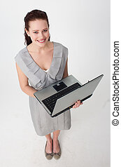 High angle of a businesswoman using a laptop - High angle of...