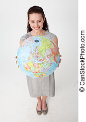 Young businesswoman holding the Earth planet - High angle of...