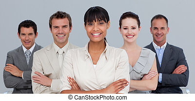 Multi-ethnic business team with folded arms - Smiling...