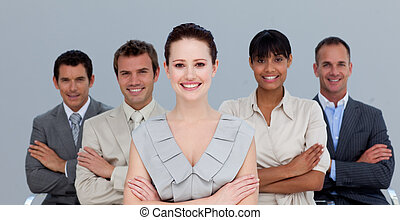 Multi-ethnic business team with folded arms