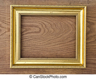 retro picture frame on oak wood plank background