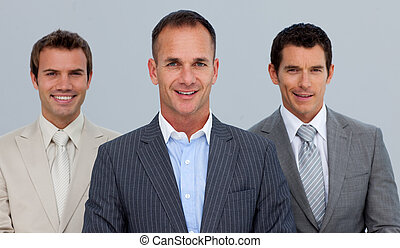 Portrait of smiling businessmen with folded arms - Portrait...