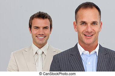 Portrait of smiling businessmen with folded arms
