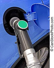 fuel station - At the gas station pump putting gas into the...
