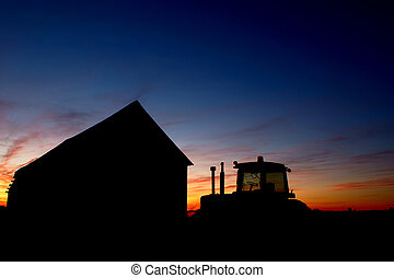 Barn and Tractor - A tractor sitting outside a barn on a St...