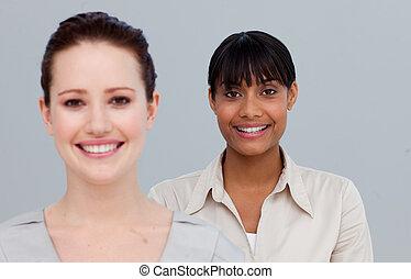 Portrait of smiling businesswomen - Portrait of two...