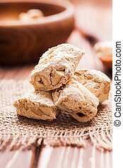 Nougat , typical italian dessert with nuts on a rustic table