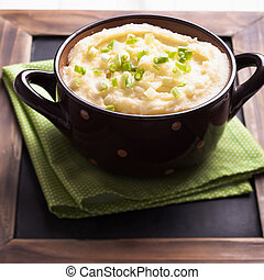 Mashed potato in a bowl with green onion
