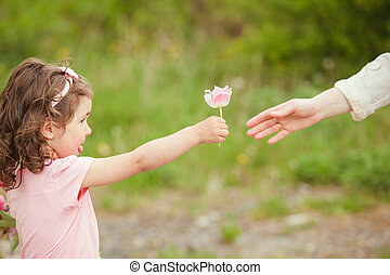 Mother day - Daughter gives a flower for mom, Mothers day