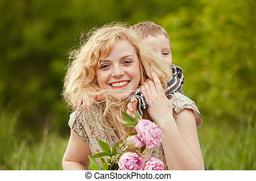Mother day - Mom with son and flowers for the Mothers day